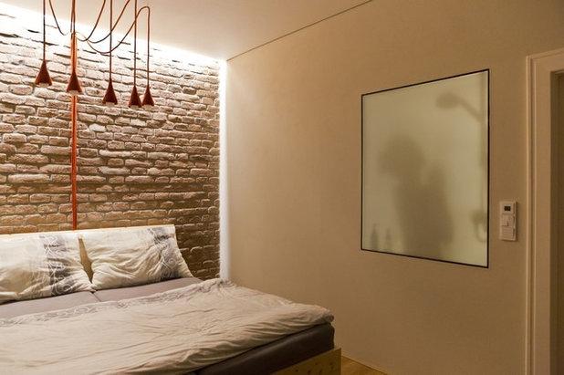 Moderno Camera da Letto by atelier VIZAGE