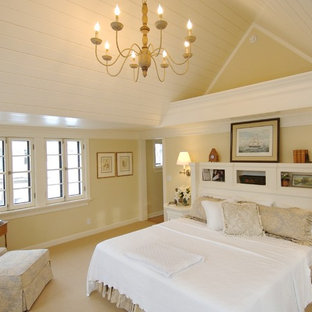 This is an example of a large traditional master bedroom in Minneapolis with beige walls and carpet.
