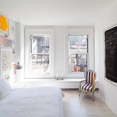 Small danish master light wood floor bedroom photo in New York with white walls