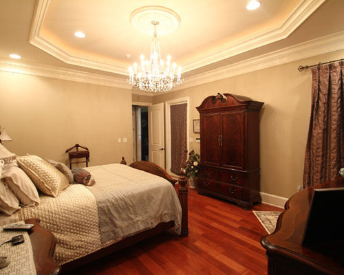 Large Traditional Master Medium Tone Wood Floor Bedroom Idea In New Orleans
