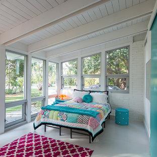 Bedroom - mid-sized contemporary bedroom idea in Miami with blue walls