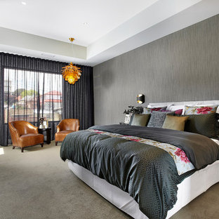 Photo of a large contemporary bedroom in Melbourne with grey walls and carpet.