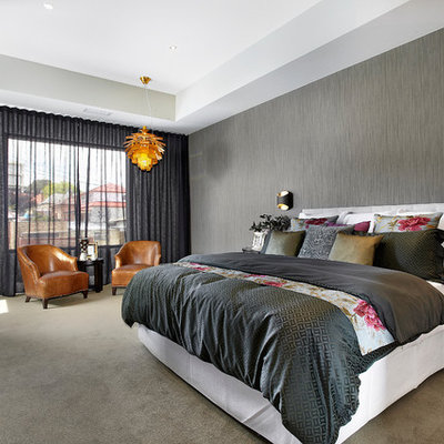 Inspiration for a large contemporary carpeted bedroom remodel in Melbourne with gray walls