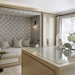 Design ideas for a mid-sized modern master bedroom in Manchester with grey walls, marble floors, beige floor and panelled walls.