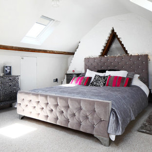 Design ideas for a medium sized bohemian guest bedroom in Sussex with white walls, carpet and grey floors.
