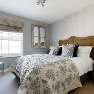 Design ideas for a small rural master bedroom in Sussex with grey walls, carpet, no fireplace and brown floors.