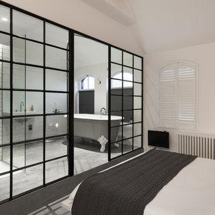 ロンドンのインダストリアルスタイルのおしゃれな寝室のレイアウト