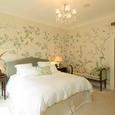 Elegant carpeted bedroom photo in London with multicolored walls
