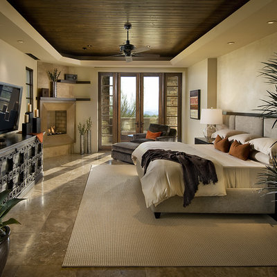 Inspiration for a contemporary bedroom remodel in Phoenix with beige walls and a corner fireplace