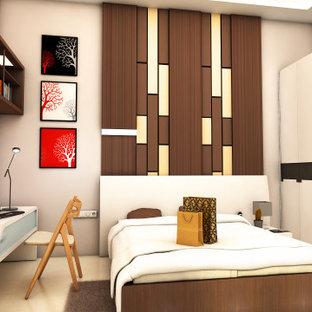 Ejemplo de dormitorio principal, minimalista, pequeño, con paredes beige, suelo de baldosas de porcelana, chimenea de esquina, marco de chimenea de ladrillo y suelo beige
