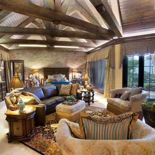 Inspiration for a huge eclectic master limestone floor and beige floor bedroom remodel in Austin with beige walls, a standard fireplace and a stone fireplace