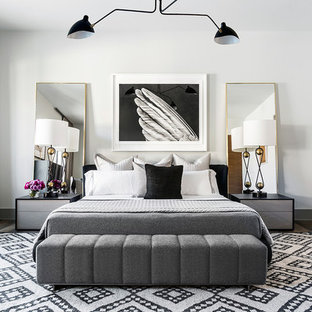 Design ideas for a contemporary master bedroom in Houston with white walls, dark hardwood flooring and brown floors.