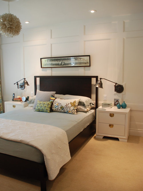 Example of a trendy carpeted bedroom design in Toronto with white walls