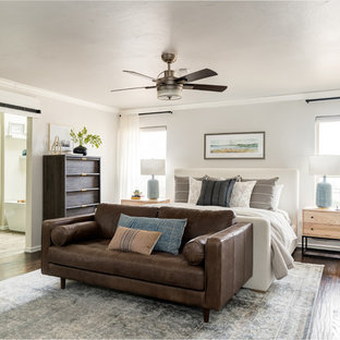 Example of a classic master dark wood floor and brown floor bedroom design in Oklahoma City with gray walls