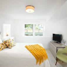 Midcentury Bedroom by Sarah Gallop Design Inc.