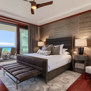 Inspiration for a large contemporary master medium tone wood floor and red floor bedroom remodel in Hawaii with gray walls and no fireplace
