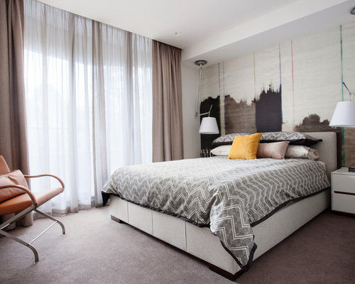 Concealed With Curtain Mid-sized contemporary bedroom idea in Melbourne with white walls and carpet