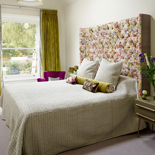 Large transitional master carpeted bedroom photo in Sussex with beige walls