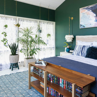 Large country master bedroom in Other with green walls, light hardwood floors, no fireplace and white floor.