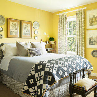 Inspiration for a traditional bedroom in New York with yellow walls, carpet, no fireplace and beige floor.