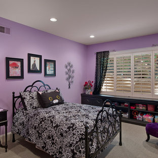 Mid-sized midcentury guest bedroom in Orange County with purple walls and carpet.