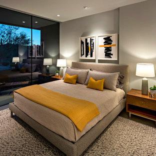 Diseño de habitación de invitados actual, grande, con paredes blancas, suelo de cemento y suelo gris