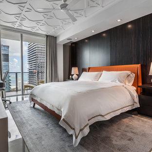 Example of a trendy gray floor bedroom design in Miami with brown walls