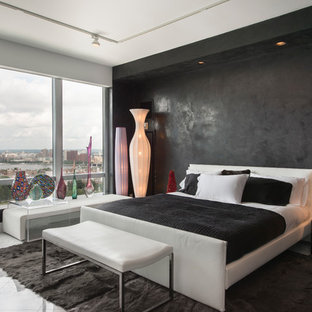 Photo of a large contemporary master bedroom in Boston with black walls and marble flooring.