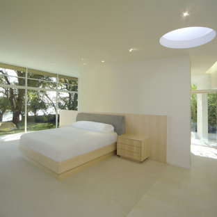 Large minimalist master limestone floor bedroom photo in San Francisco with beige walls and no fireplace
