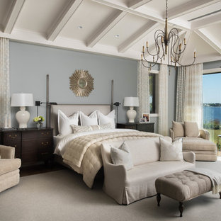 Elegant carpeted and gray floor bedroom photo in Miami with gray walls