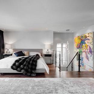 Foto de dormitorio principal, actual, de tamaño medio, con paredes blancas, suelo de madera oscura, chimenea lineal y marco de chimenea de baldosas y/o azulejos