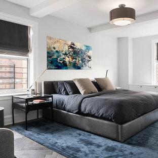 Bedroom - contemporary master dark wood floor and brown floor bedroom idea in New York with white walls