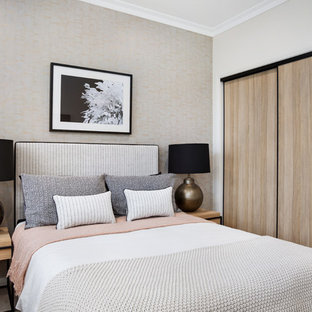 Photo of a contemporary guest bedroom in Sydney with beige walls, carpet and beige floor.