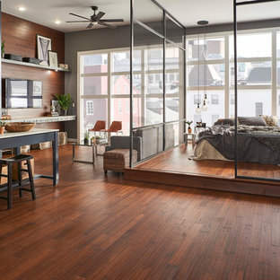 This is an example of a modern loft-style bedroom in Other with bamboo floors and brown floor.