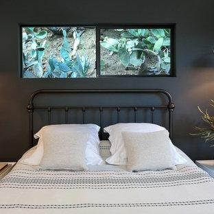 Bedroom - contemporary bedroom idea in Los Angeles with black walls