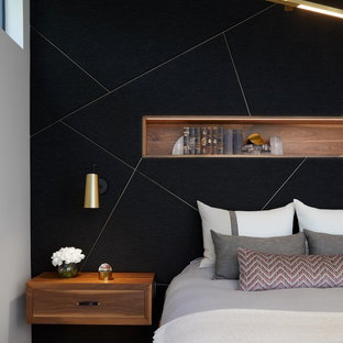 Trendy master dark wood floor bedroom photo in Austin with black walls