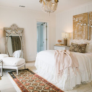 This is an example of a traditional bedroom in Atlanta with white walls.