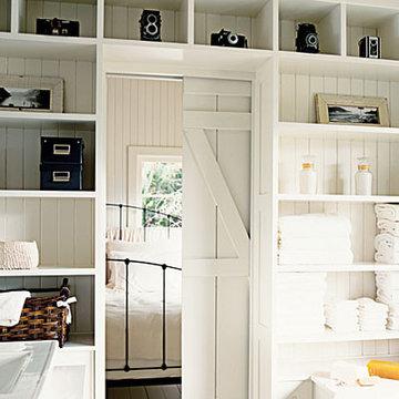 room dividers, pocket door, barn doors, open shelving storage, bedrooms, white