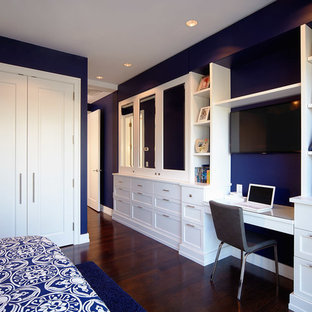 Photo of a contemporary bedroom in Philadelphia with blue walls, dark hardwood flooring and no fireplace.