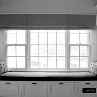 Mid-sized trendy master dark wood floor bedroom photo in New York with gray walls
