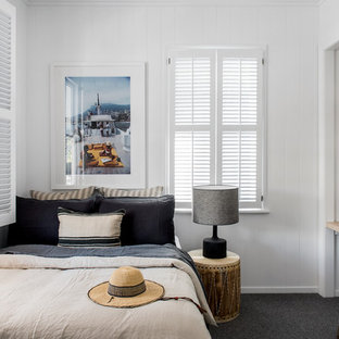 Beach style bedroom in Brisbane with white walls, carpet and grey floor.
