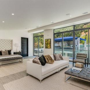 Bedroom   Huge Contemporary Gray Floor Bedroom Idea In Los Angeles With  White Walls