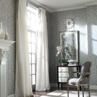 На фото: хозяйские спальни среднего размера в стиле современная классика с серыми стенами, темным паркетным полом, стандартным камином, фасадом камина из штукатурки и коричневым полом