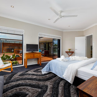 Design ideas for a beach style master bedroom in Gold Coast - Tweed.