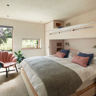 Inspiration for a rustic guest bedroom in Devon with beige walls, carpet, no fireplace and beige floors.