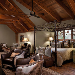 Large mountain style medium tone wood floor bedroom photo in Other with brown walls