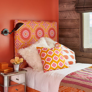 Mountain style guest bedroom photo in Denver with orange walls