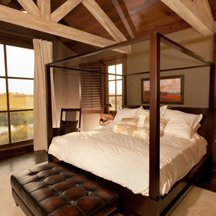 Inspiration for a rustic dark wood floor bedroom remodel in Other with brown walls