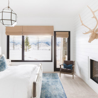 Example of a mountain style carpeted and beige floor bedroom design in Salt Lake City with white walls