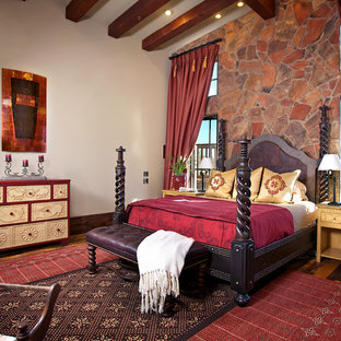 Inspiration for a rustic dark wood floor bedroom remodel in Phoenix with white walls